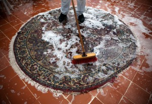 Carpet Cleaning Group employee providing oriental rug cleaning